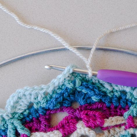Starting with a slip stitch on your hook, insert hook into ch-2 sp.